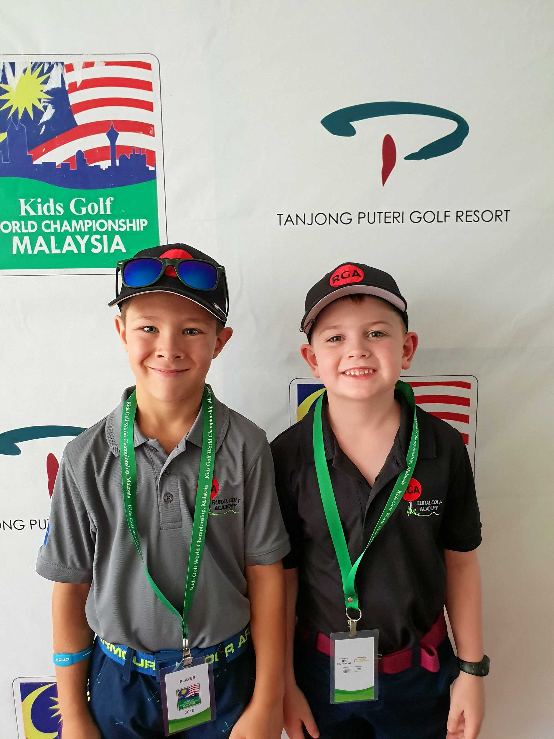 Rockhampton's Riley Milliner and Eli Parsons at the US Kids Golf World Championships in Malaysia.