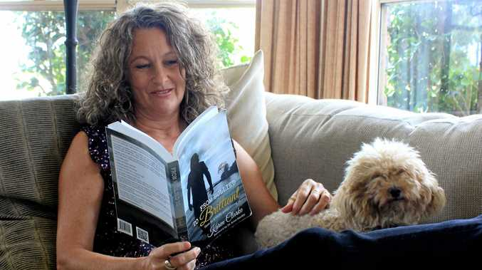 NEW LIGHT: Author Karen Clarke, pictured with her reading partner Toby, believes we need to look at bullying differently.
