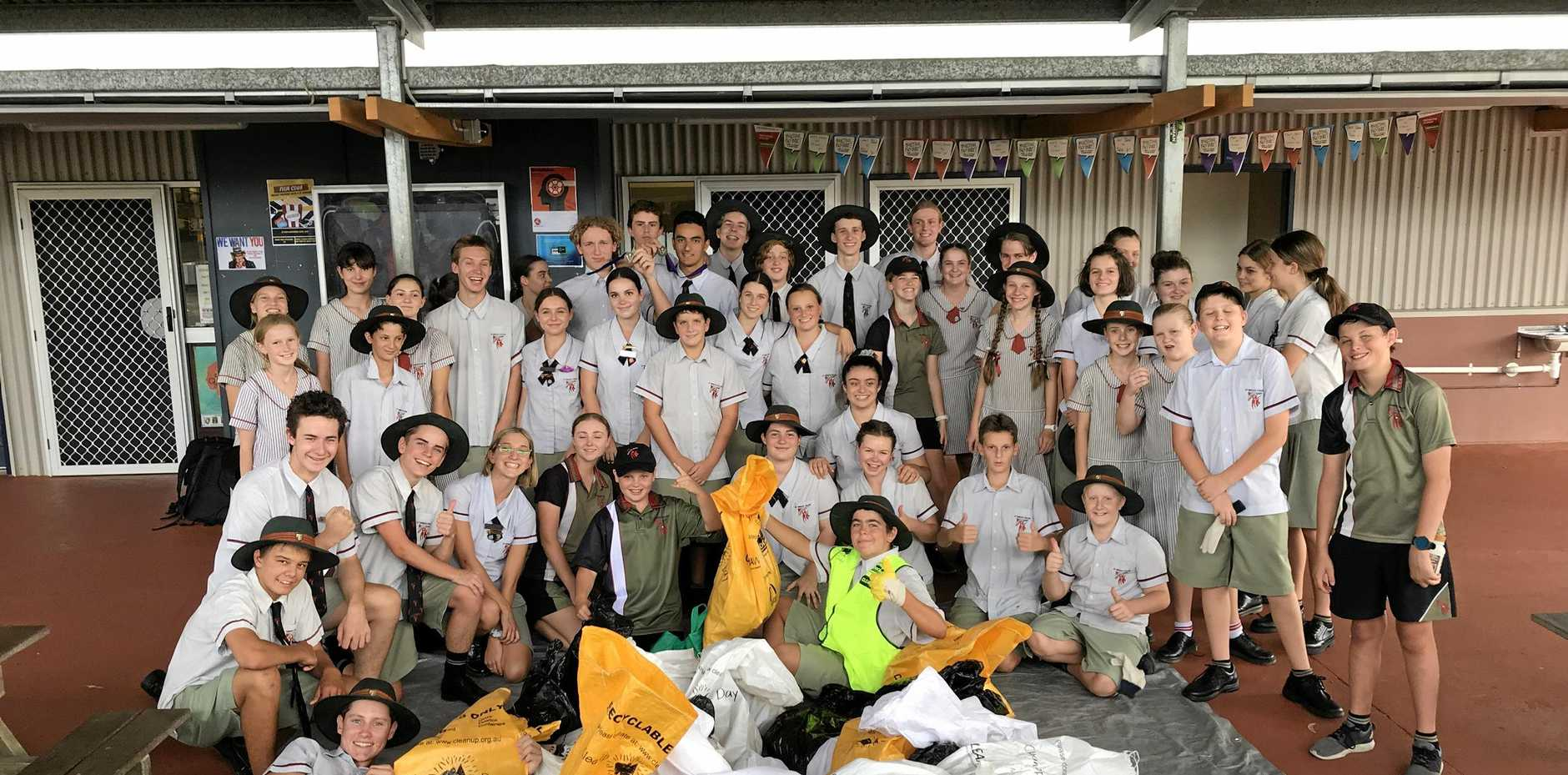 CLEANING UP: St Teresa's Catholic College students held their annual tidying up of the school grounds.