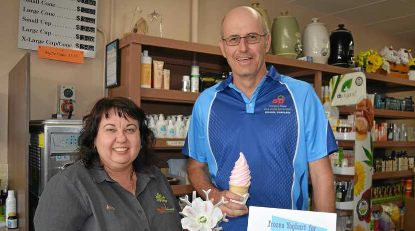 DAIRY GOOD: Funds raised from selling frozen yoghurt will be used to support Chappy Matt's service at three Lockyer Valley Schools. Pictured: Anita Lyne and Chappy Matt.