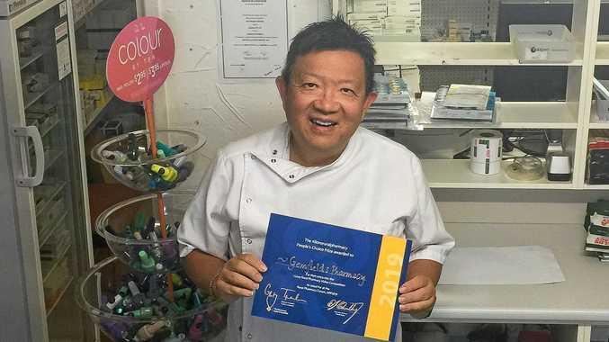 PROUD: Manager Adrian Lim celebrates Gemfields Pharmacy winning the People's Choice award.