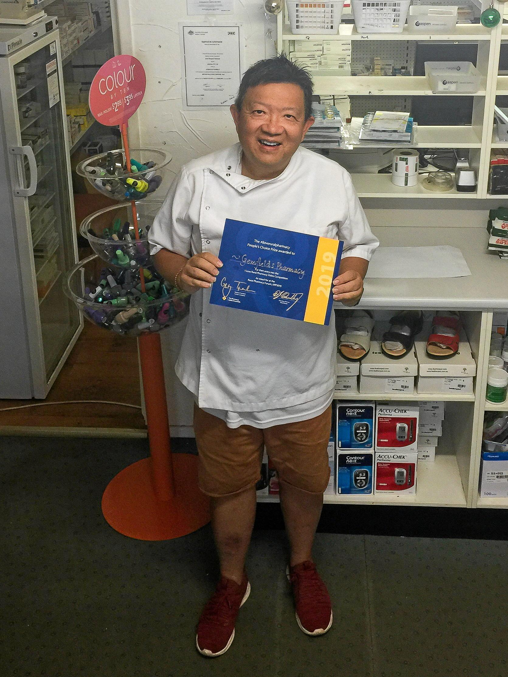 PROUD: Manager Adrian Lim celebrates Gemfields Pharmacy winning the People's Choice award.