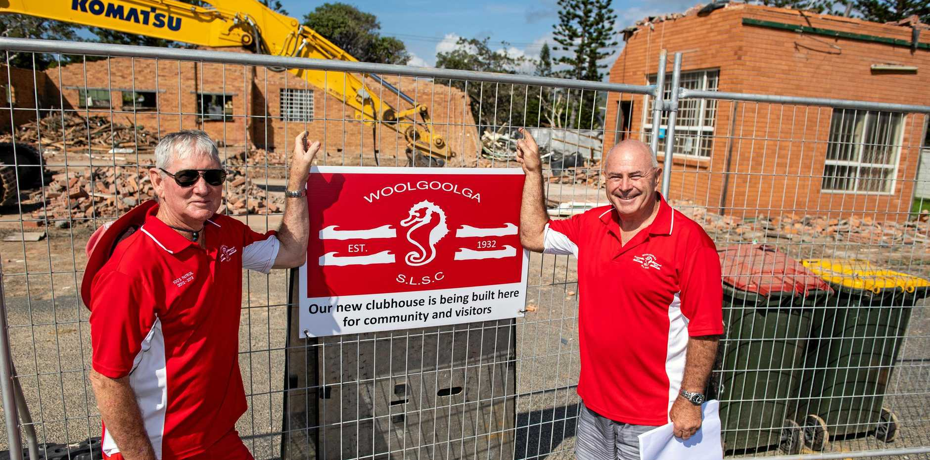 Neville Cleary and Les Pepper look on as the last of the old marine rescue building is taken down to make way for the new surf club.