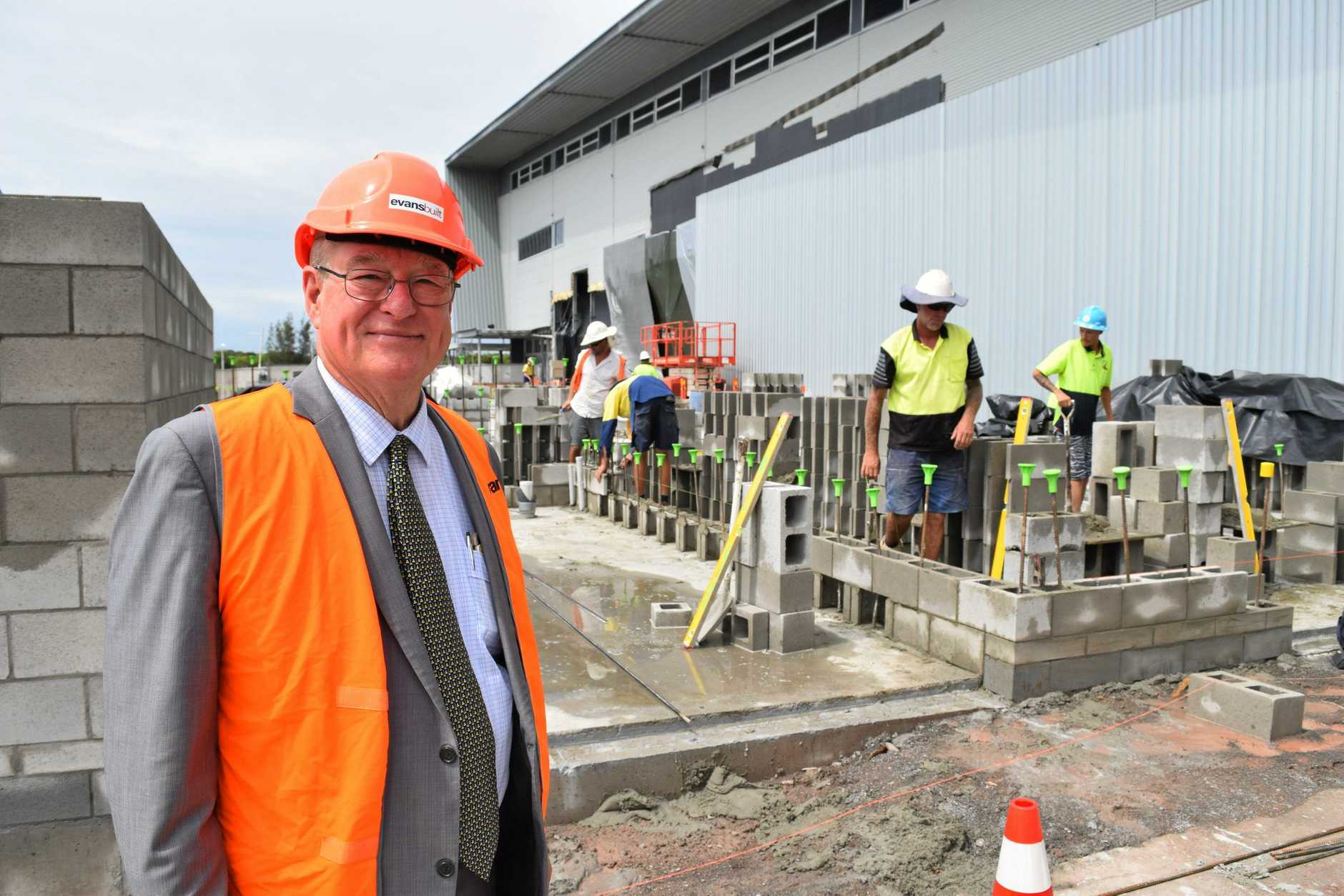 University of the Sunshine Coast Vice-Chancellor Professor Greg Hill oversees progress of an upgrade to USC Stadium.