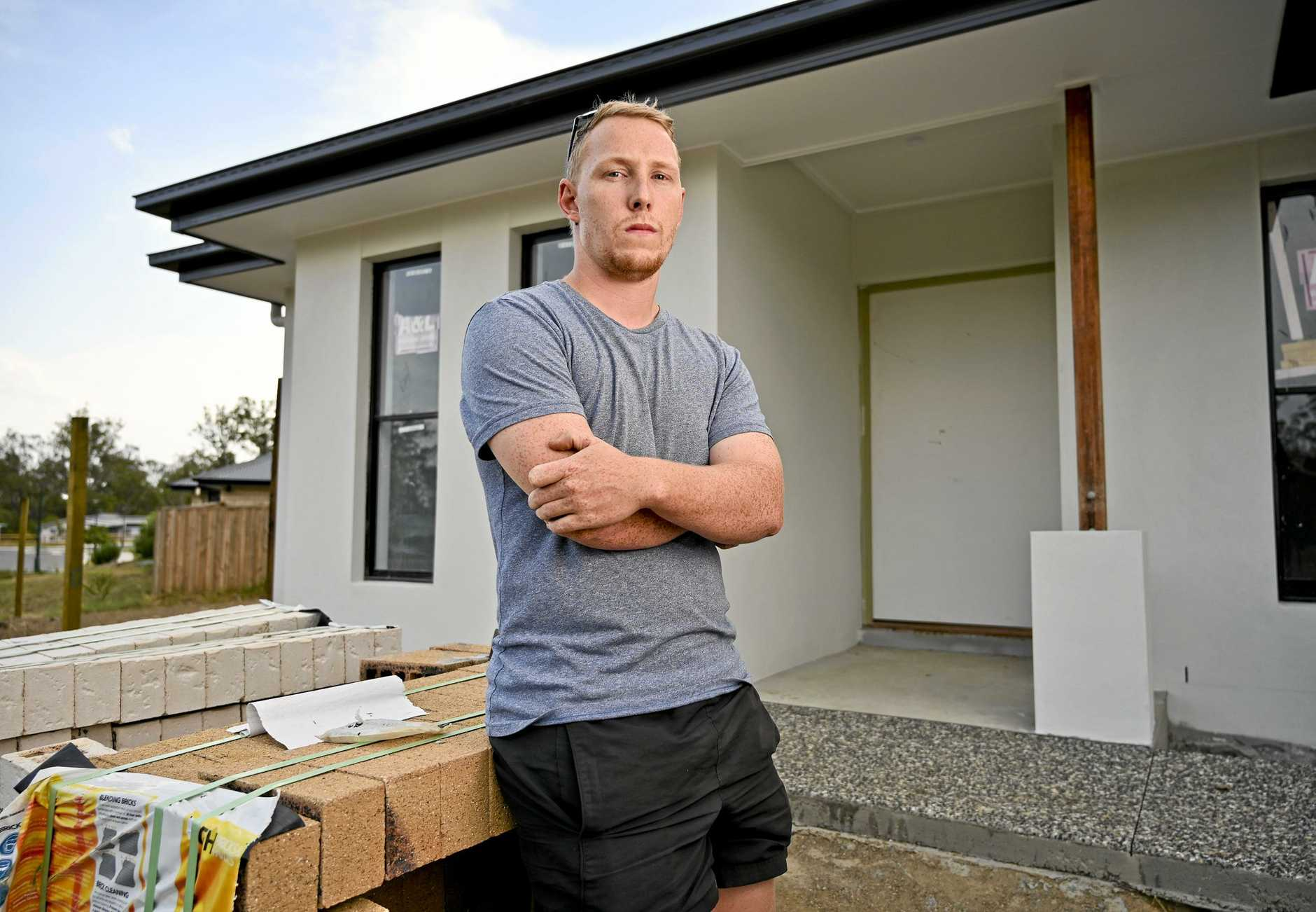 Callum Lowe in his unfinished Rosewood home following the G.J. Gardner collapse. Picture: Cordell Richardson