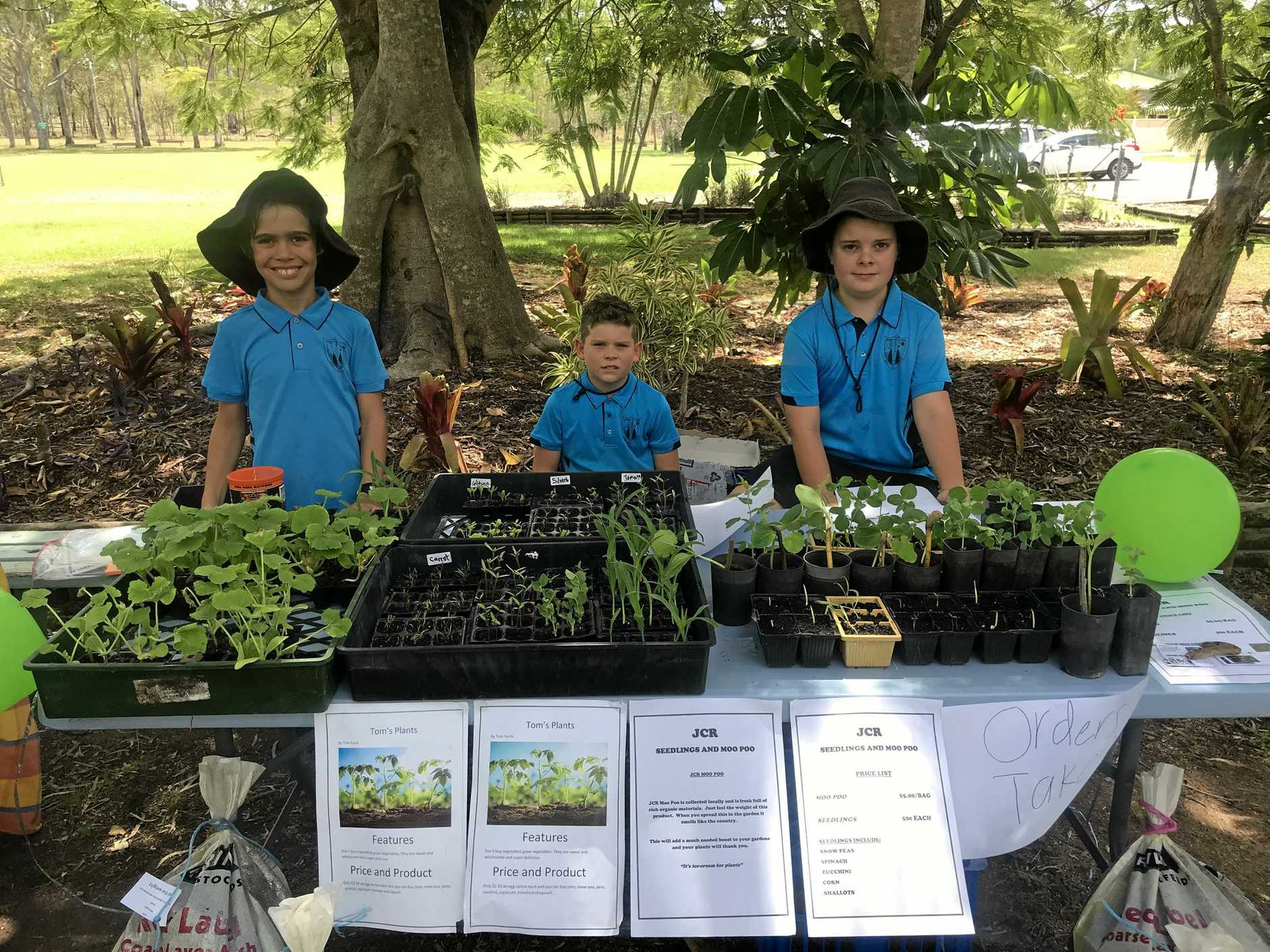 BUSINESS SAVVY: Year 5s Tom Ferris with Tom's Plants, Cooper Filian with Cooper's Can Collection and Jack Ritchie with JCR Seedlings and Moo Poo at the Bororen State School Market Day held as part of the EarlyPrenuer program.