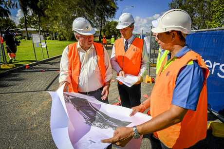 Member for Flynn Ken O'Dowd, Associate vice chancellor of CQU in the Gladstone Region, Professor Owen Nevin, Project manager of Paynters Matt Hogg and CQU Senior Project manager Arvind Singh look over the plans for CQUniversity's Trades training Centre.