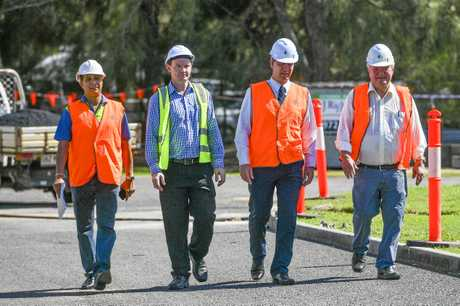 Member for Flynn Ken O'Dowd, Associate vice chancellor of CQU in the Gladstone Region, Professor Owen Nevin, Project manager of Paynters Matt Hogg and CQU Senior Project manager Arvind Singh walk through the site of CQUniversity's Trades training Centre.