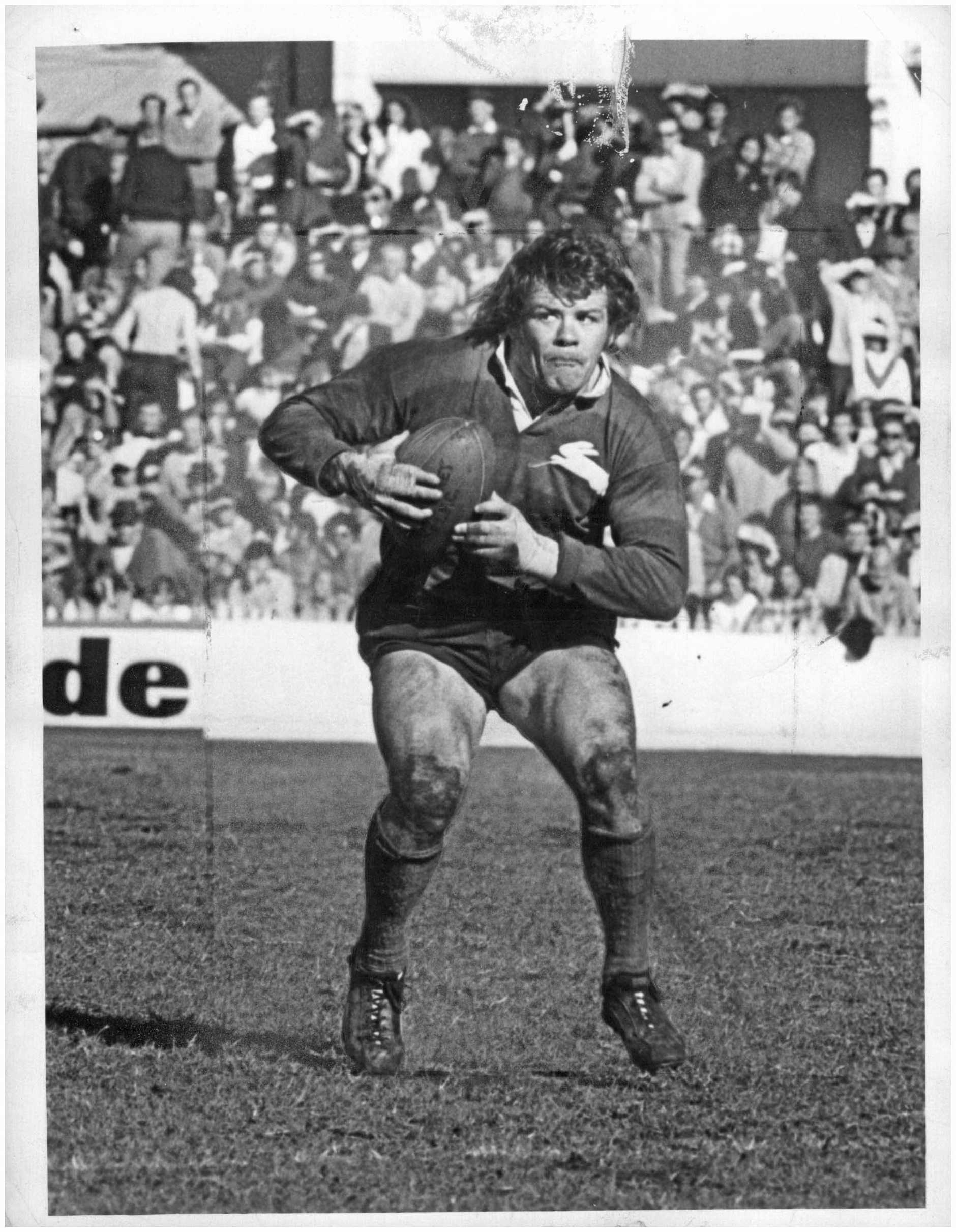 **This picture has a scanned reverse - see associated content at the bottom of the details window**outh Sydney Rabbitohs RL player Bob McCarthy during a match in a 1970s photo.