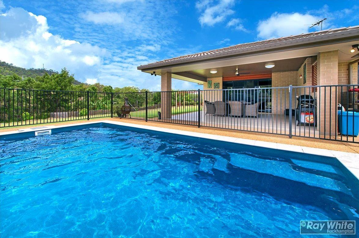 The property has an undercover patio and in-ground swimming pool to beat the summer heat. INSET: David Bell.