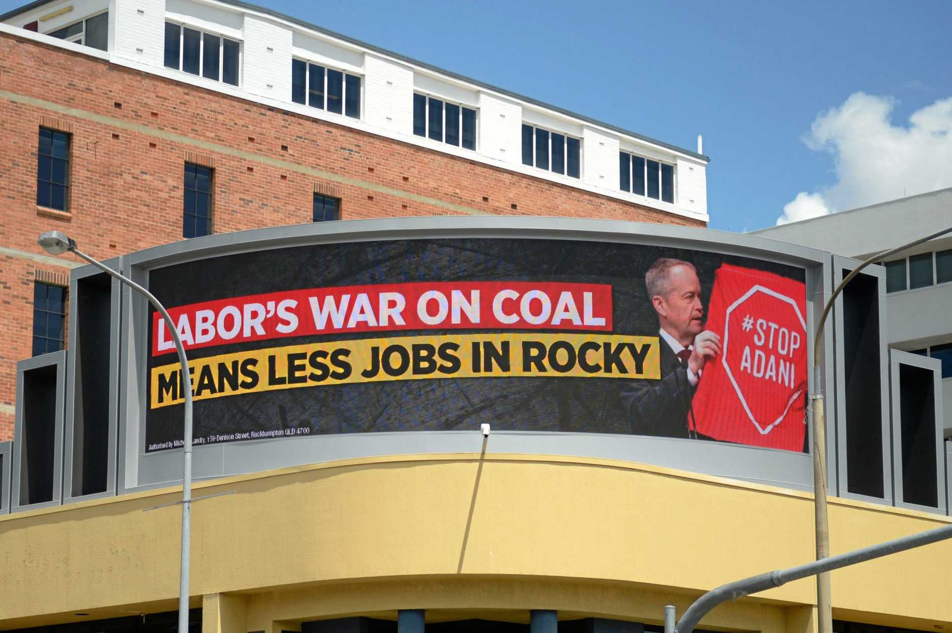COAL CAMPAIGN: The LNP's new billboard on the corner of Fitzroy and Bolsover St, Rockhampton wars of a war on coal.