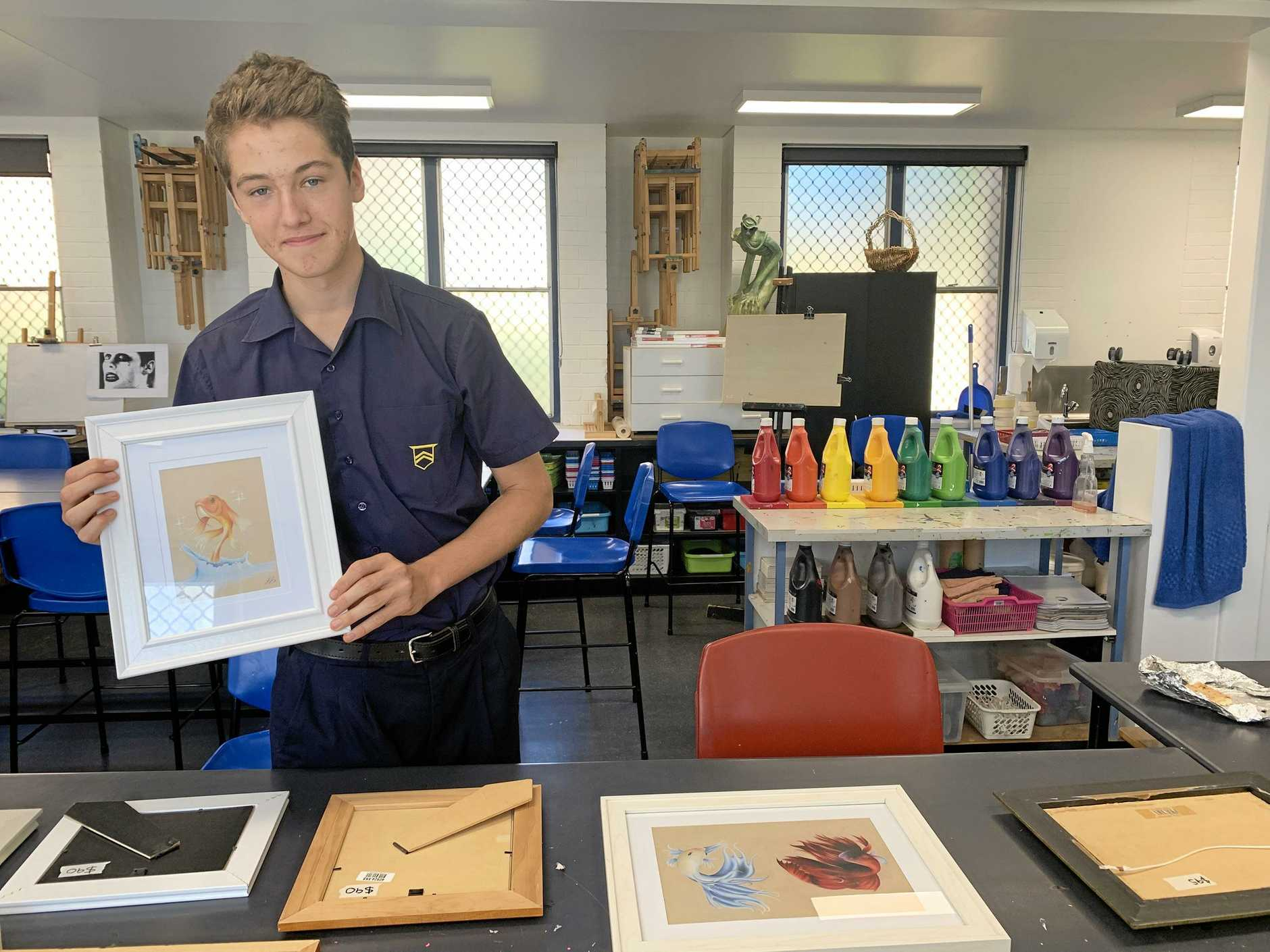 BUDDING ARTIST: Toowoomba Grammar School student Jacob Bunt with some of his artwork that will be displayed at the student art show.