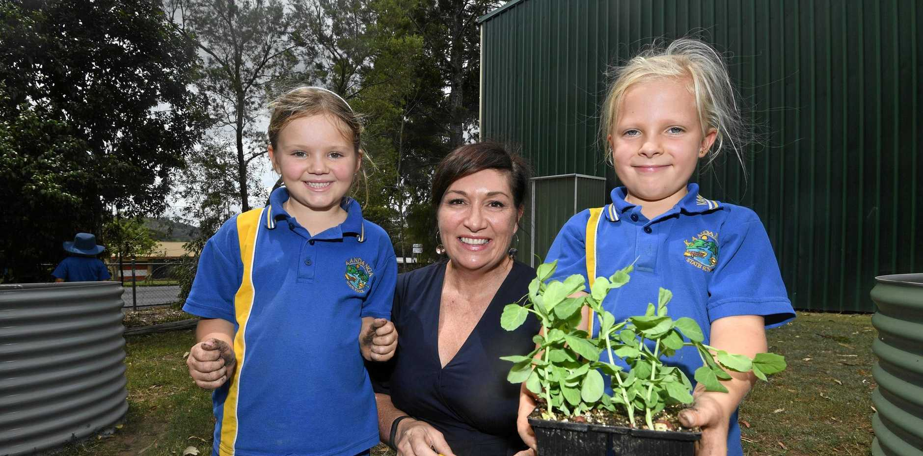 TAKING ACTION: Queensland Environment Minister Leanne Enoch with Kandanga State School students Makayla Ogan and Mia Garrett. Mrs Enoch spent an hour at the school helping students with their vegetable garden and talking about the importance of climate change.