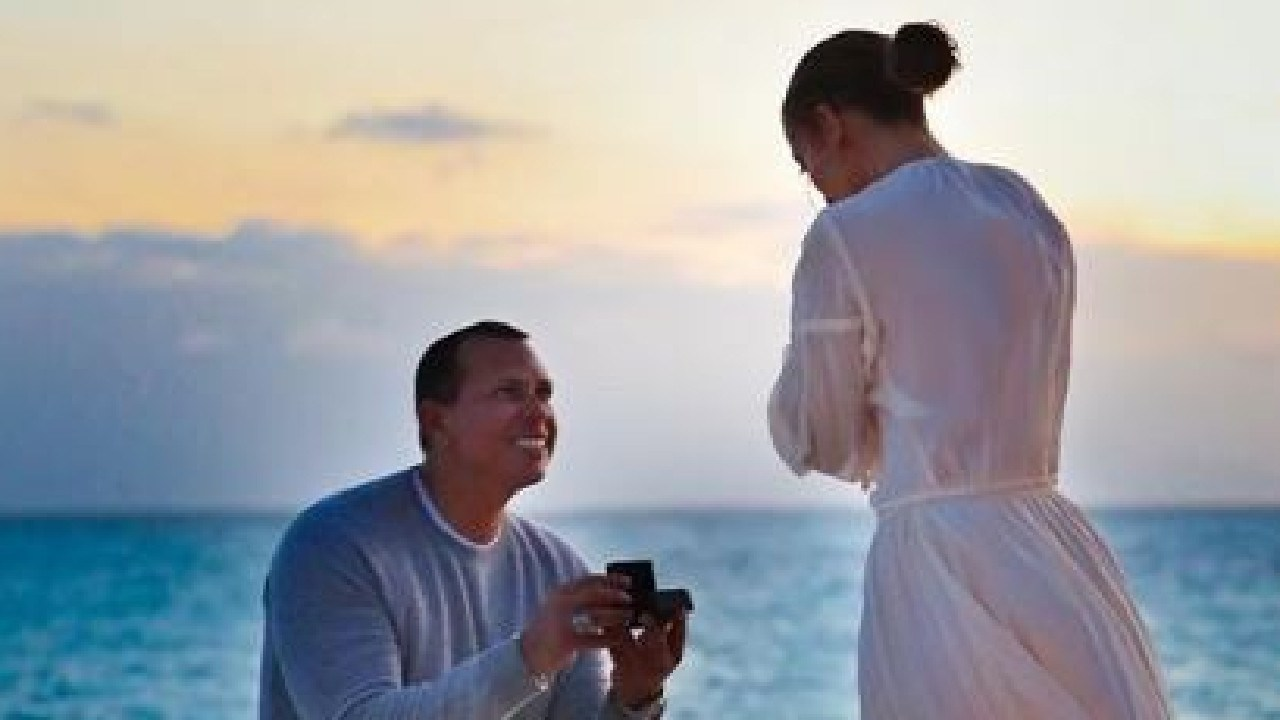 Alex Rodriguez proposing to Jennifer Lopez (J-Lo) wearing Byron Bay label Spell & The Gypsy.