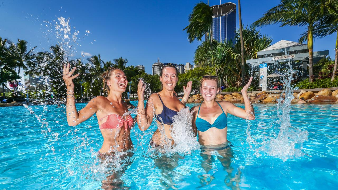 Tourism. L-R: International tourists Perrine Verhaque, Agathe Giovannoni and Manon Auffray from France cool off at Southbank. Picture: NIGEL HALLETT