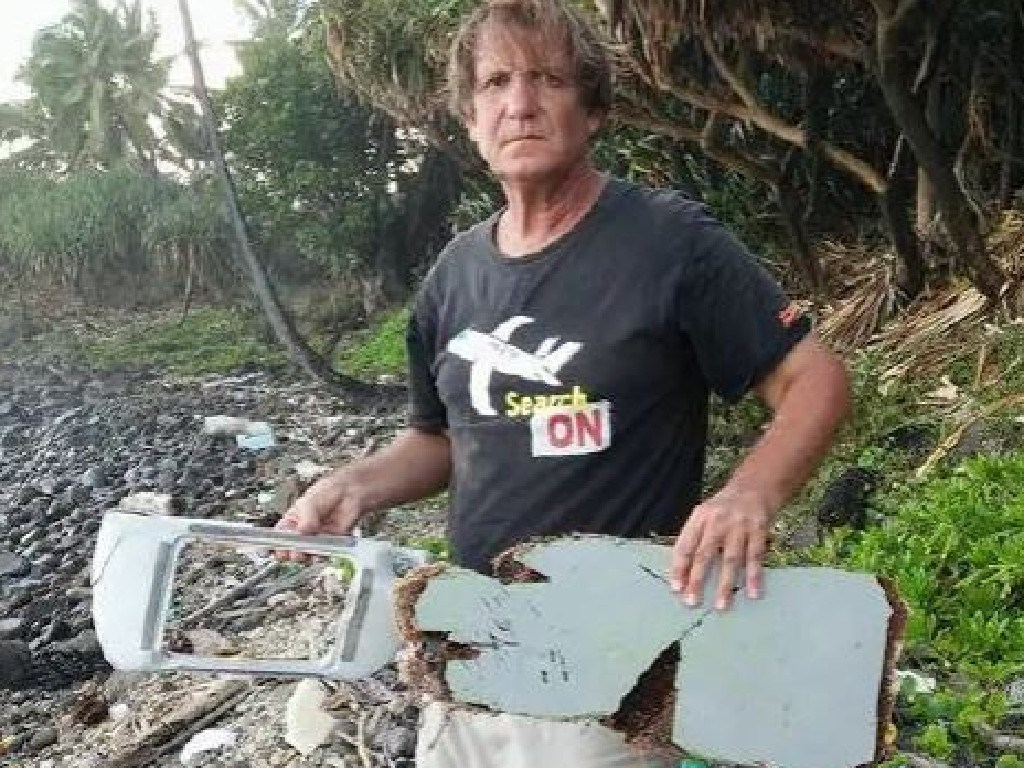 American lawyer and adventurer Blaine Gibson holds suspected debris from MH370. Picture: Blaine Alan Gibson/Facebook