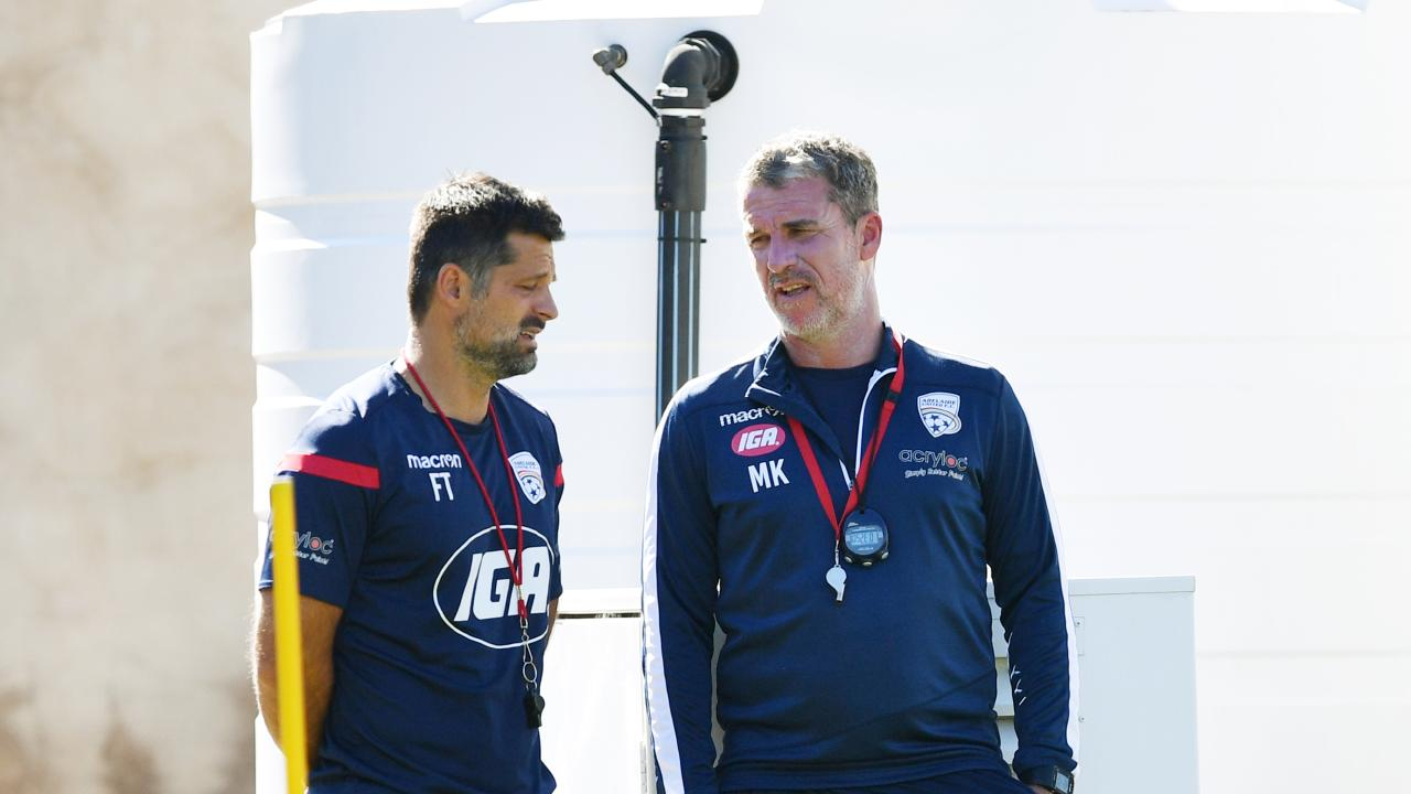 Marco Kurz (right) and assistant coach Filip Tapalovic are waiting to find out about their futures at Adelaide United. (Picture: AAP Image/David Mariuz)