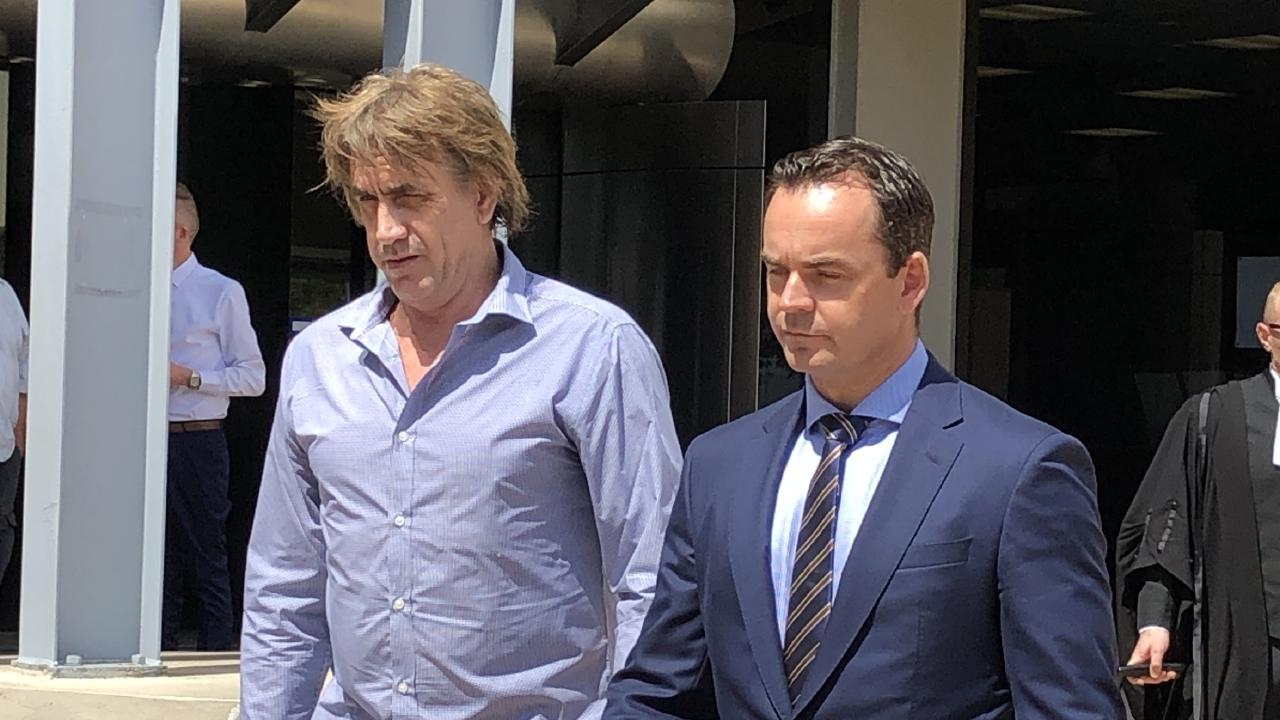 Darren Rodney Rose (left) leaves Southport Courthouse with his lawyer Tim Smith, of Moloney MacCallum Abdelshahied Lawyers. Picture: Lea Emery