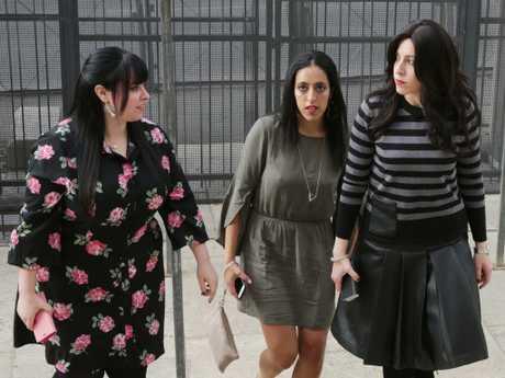 Alleged Melbourne victims; Nicole Meyer (stripy jumper), Elly Sapper and Dassi Erlich (flower dress) arrive at a court in Jerusalem. Picture: Ella Pellegrini