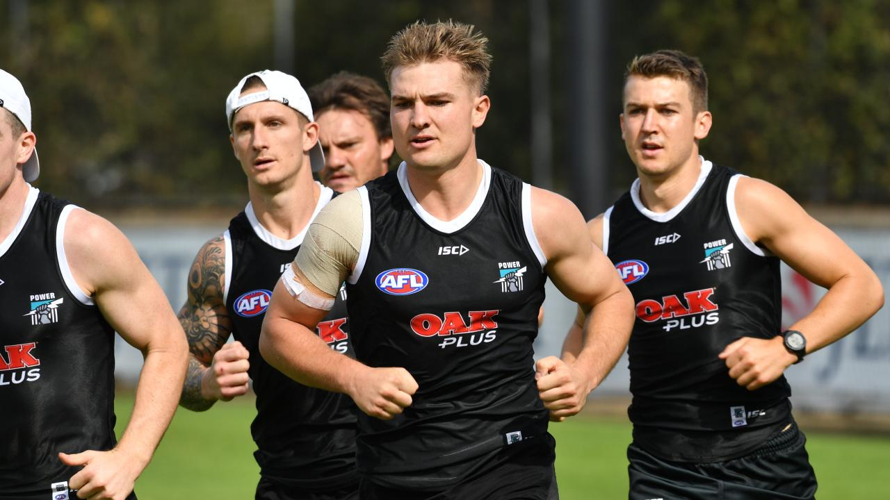 Michael Voss has given co-captain Ollie Wines just a slim hope of playing in Round 1. Picture: Keryn Stevens