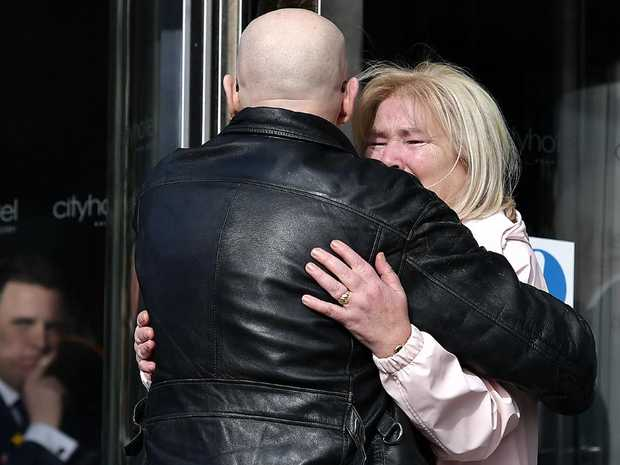 Two people embrace outside the City Hotel in Londonderry, Northern Ireland after the court ruling. Picture: Getty Images