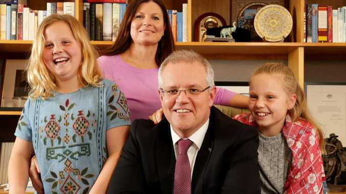 PM Scott Morrison with his wife Jenny and their daughters Lily, nine, (left) and Abbey, 11, at Parliament House in Canberra. Picture: Jonathan Ng