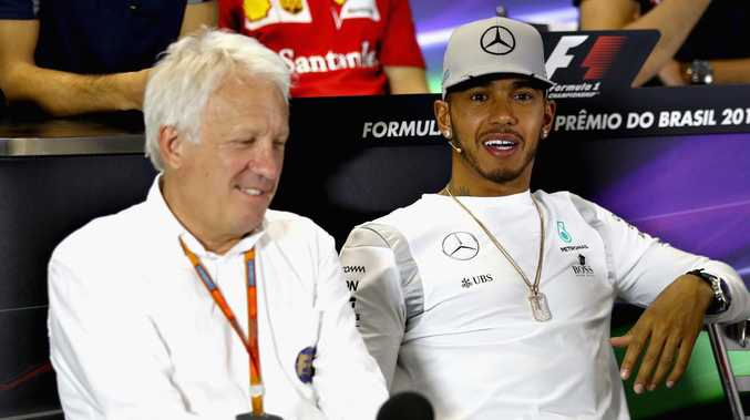 Charlie Whiting with F1 champion Lewis Hamilton. (Photo by Clive Mason/Getty Images)