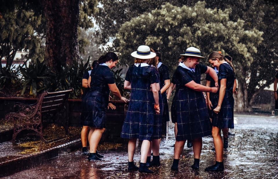 Boarders from Fairholme College enjoy the rain.