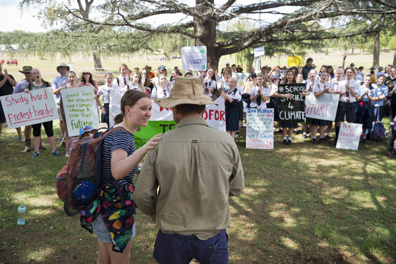 Dairy farmer David Vonhoff is comforted by rally organiser Rinny Power after giving an emotional talk to the student protest for action on climate change for the national School Strike for Climate, Friday, March 15, 2019.