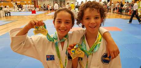 WORLD CHAMPIONS: Athletes from Ballina Taekwon-Do including siblings Olivia, 10 and Christopher Kyprianou, 11, who were gold medallist sin pattern and sparring, shone brightly to help Australia take out the top spot on the podium at World CHITF Taekwon-Do Championships in Melbourne on March 9 and 10, 2019.