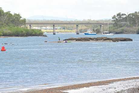 Kids enjoy the low tide on the Boyne River.