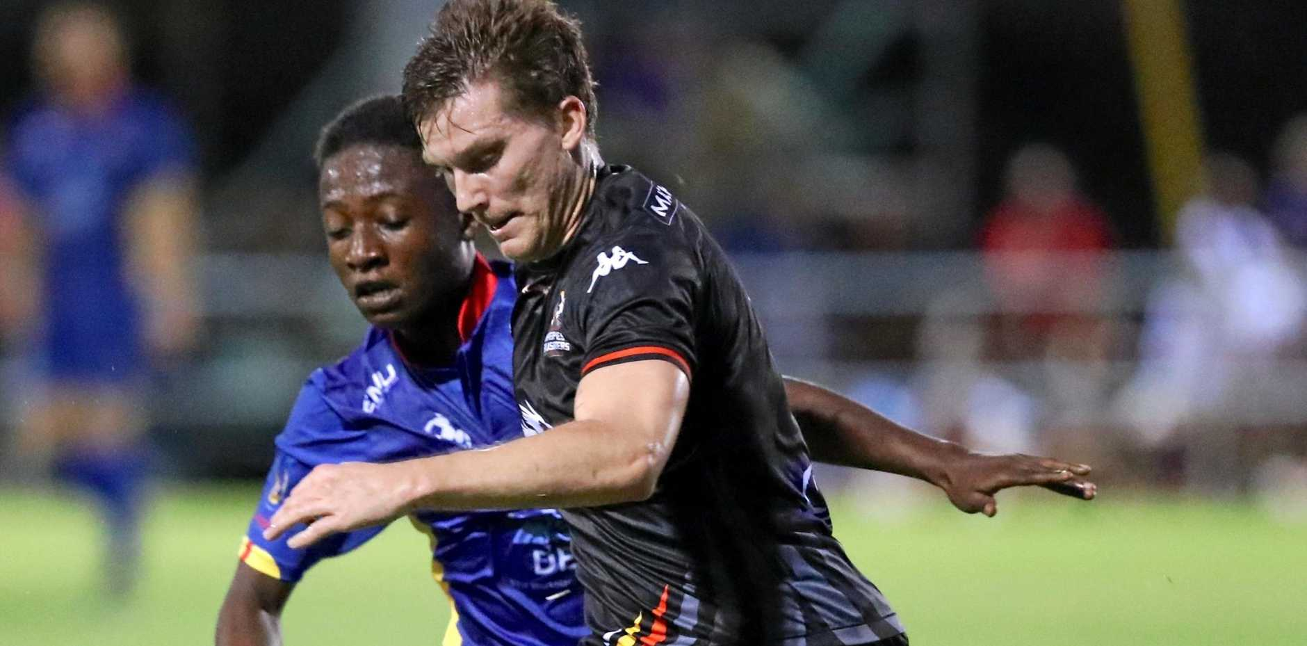 Magpies Crusaders' Warrick Jansen, pictured jostling for the ball with a North Queensland United player last year, is eager to perform at home.
