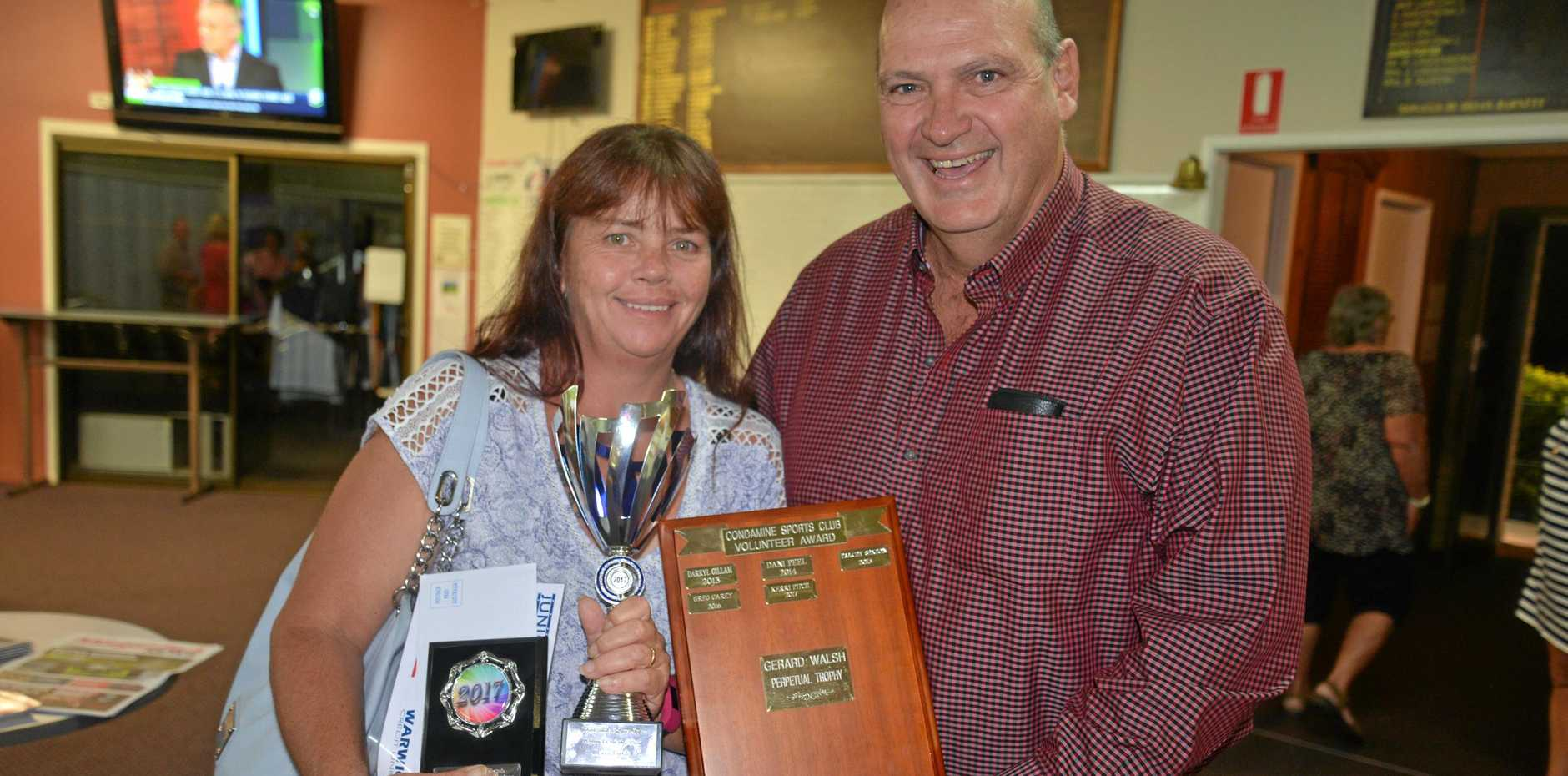 LAST YEAR'S WINNER: Condamine Sports Club Volunteer of the Year Kerri Fitch for 2017 with sports club president Ross Bell at the sports awards.