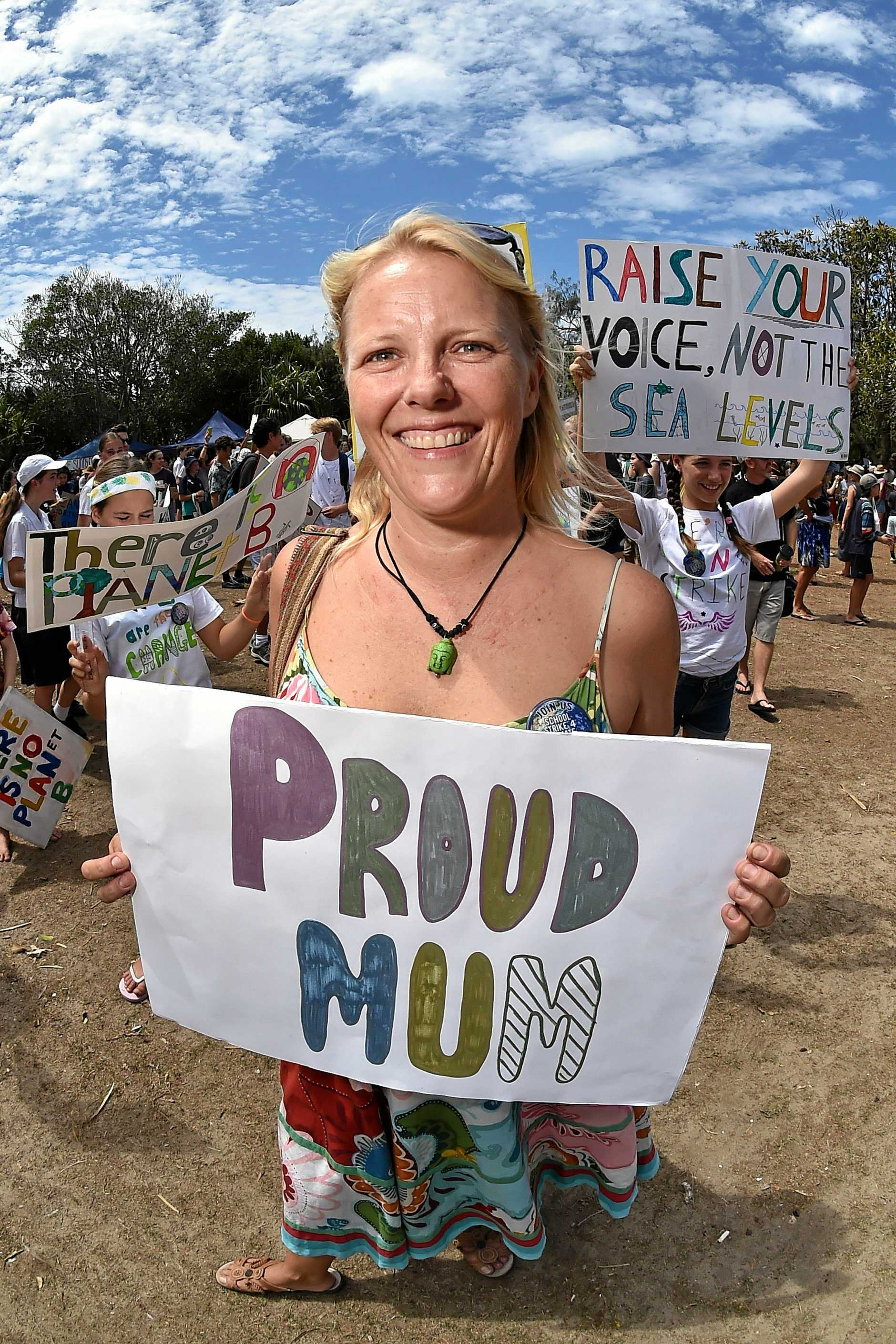 PROUD: Mum of Bridgette and Lilly Cooper, Jenny Oakley supported her daughters at the climate change strike at Peregian Beach yesterday.