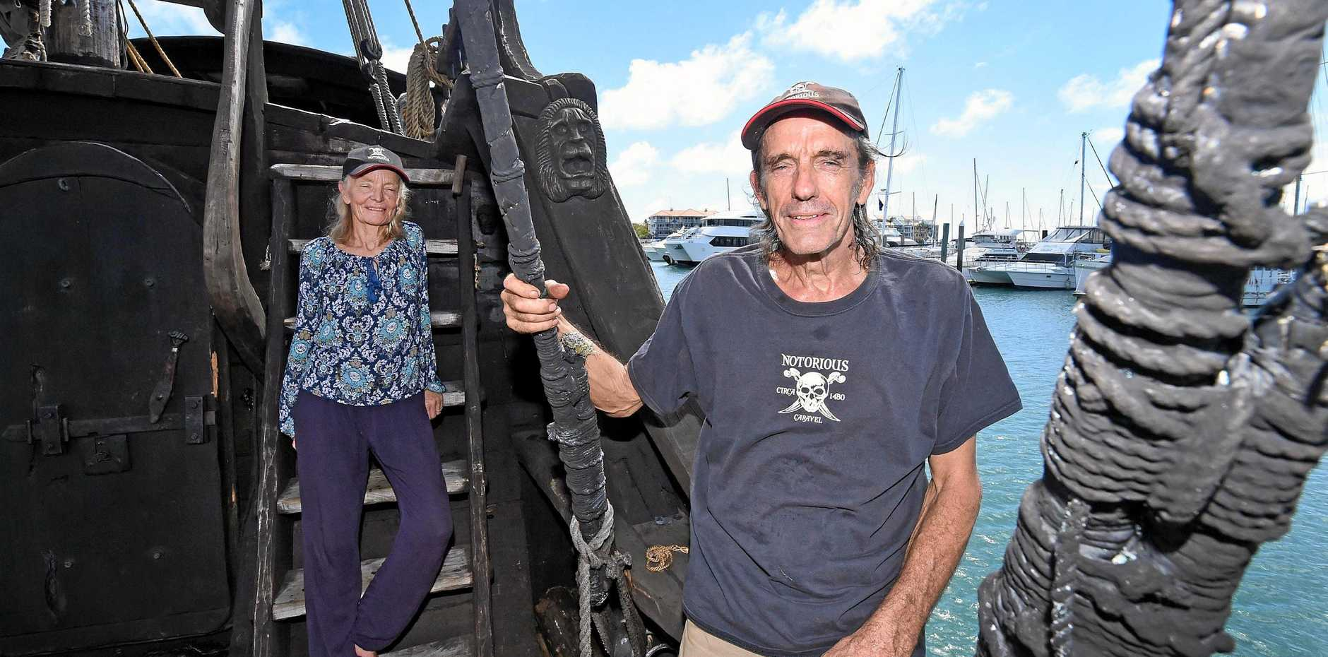 SAILING TALE: Owners Graeme and Felicity Wylie aboard the ship  Notorious .