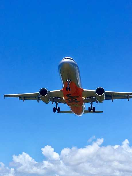 Jetstar flight takes off at Sunshine Coast Airport.