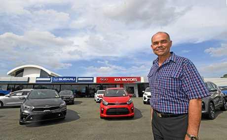 Peter Allan with the cars he hoped to sell to Gympie Regional Council.