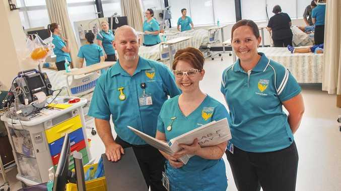 USQ nursing students Kent Dock, Stephanie Barrett and Courtney Grattan in the new simulation ward at USQ Ipswich.