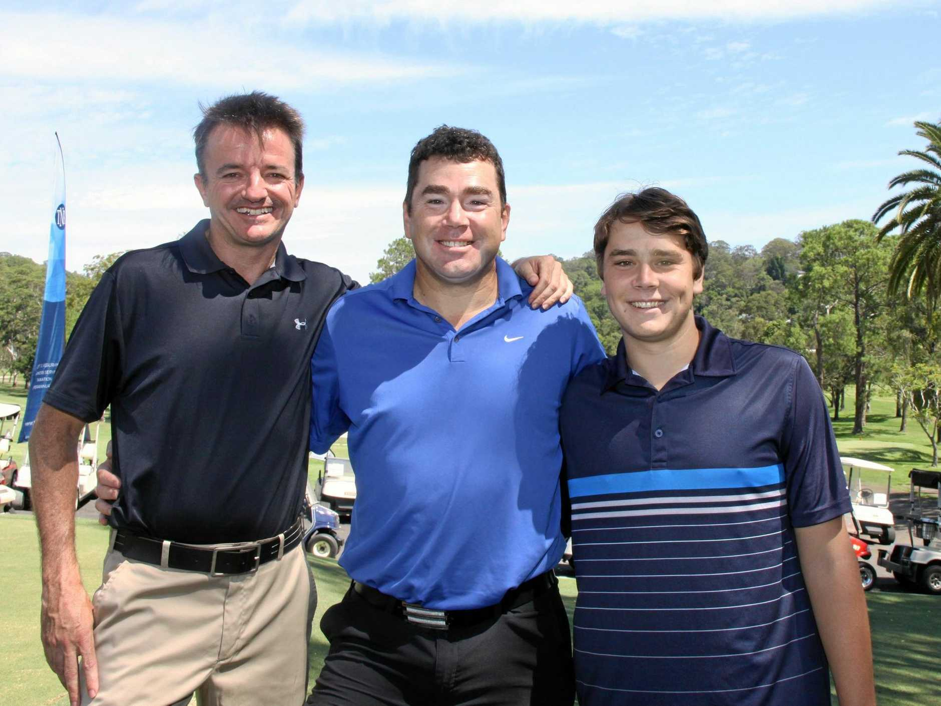 GOLF FOR GEORGIA: LWGC president Tim Gilmore with Georgia's dad Adam and older brother Nick at the fundraiser.