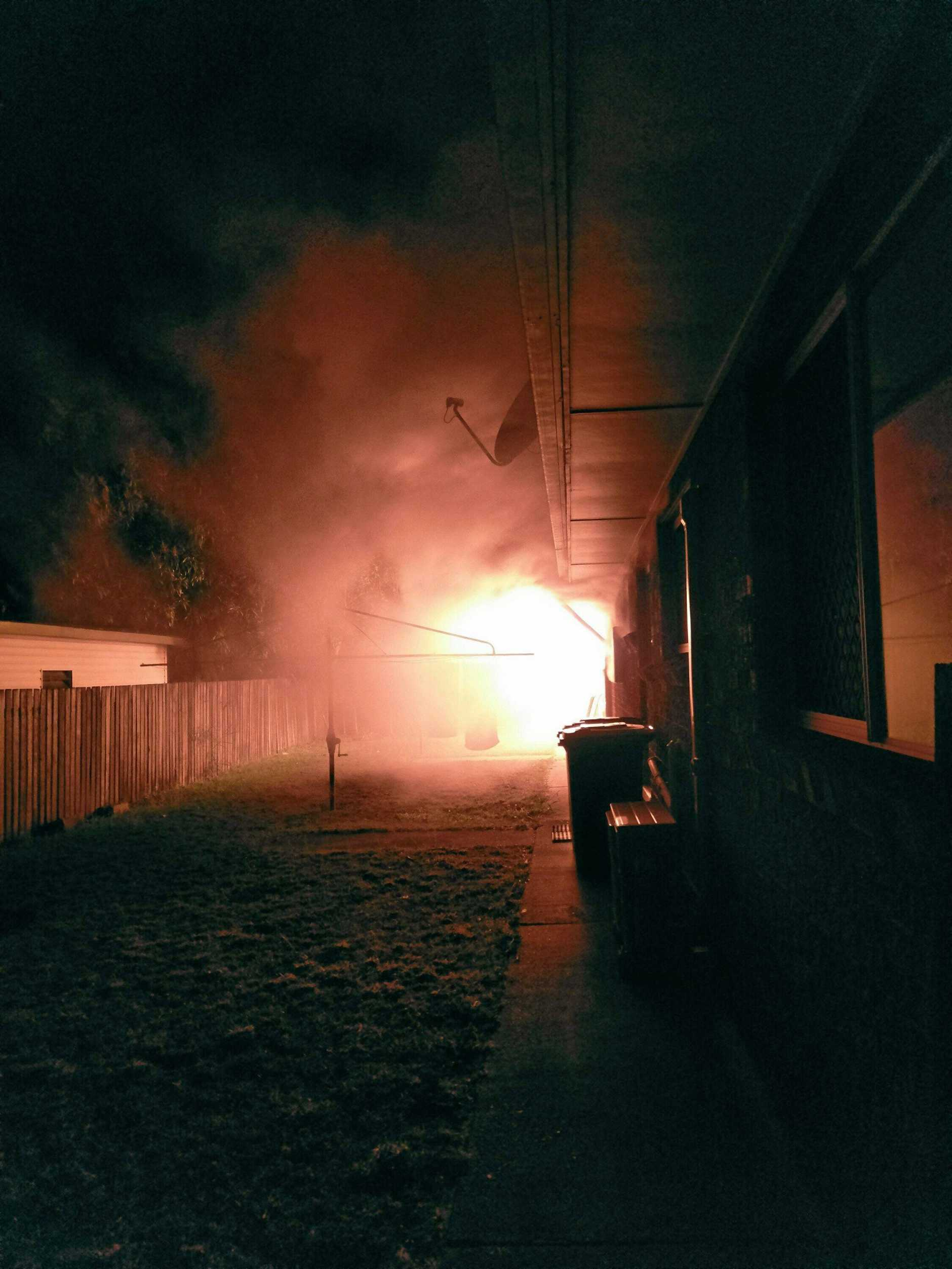 Fire on Fisher St, Bucasia, where a 42-year-old man was allegedly set alight