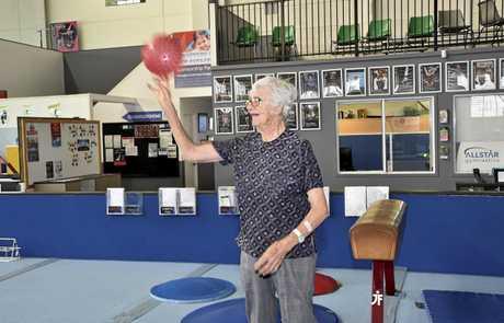 Joan Bell shoots a hoop during the class.