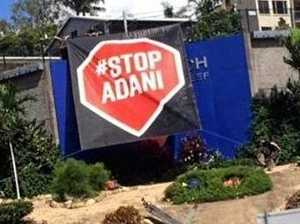 Stop Adani banner dropped at busy Airlie Beach road