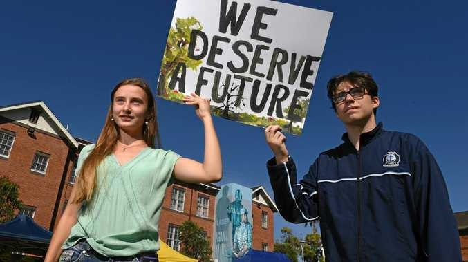 Harriet Chard and Dallas Eyles, 15, protest at the Lismore School Strike 4 Climate held in the Lismore Quad and calling for action on climate change.