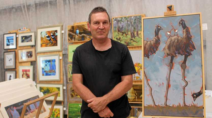 Graham Schreiber sells his art works at Markets in the Mountains.