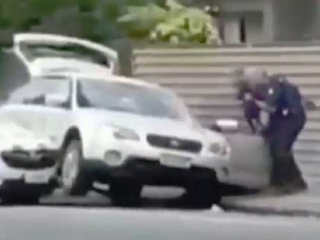 Brave police officers dragged the shooter from his station wagon. Picture: Supplied
