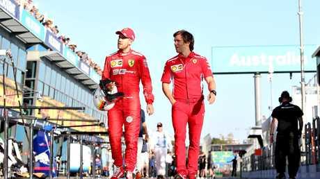 Sebastian Vettel of Germany and Ferrari walks in the Pitlane