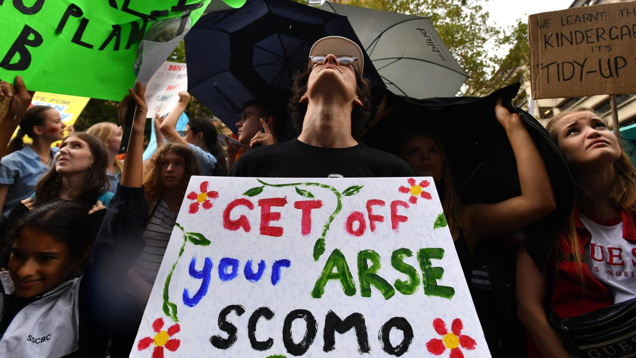 One of many signs directed at the Prime Minister at the climate change rallies. Picture: Mick Tsikas/AAP
