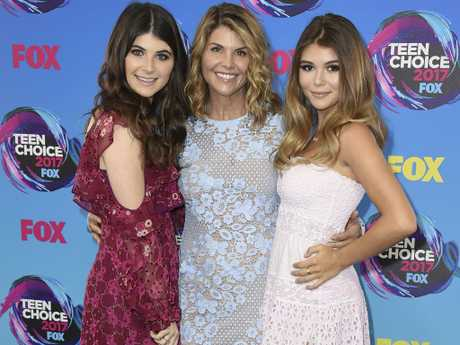 Lori Loughlin (centre) poses with her daughters Bella (left) and Olivia Jade. Picture: Jordan Strauss/Invision/AP