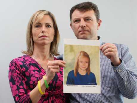 Kate and Gerry McCann hold an age-progressed police image of their daughter to mark the 5th anniversary of her disappearance. Picture: Getty