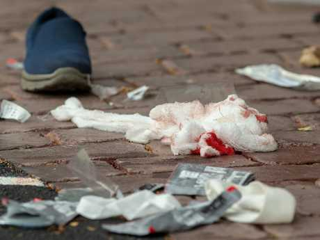 Bloodied bandages are seen on the road following the shooting at the Masjid Al Noor mosque in Christchurch. Picture: Martin Hunter/AAP